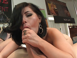 Busty brunette smiles while getting doggy style fuck